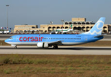 Corsair low-cost airliner. Luqa, Malta August 11, 2004: Corsair Boeing 737-4B3 [F-GFUH] slowing down on runway 32 Royalty Free Stock Image