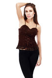 Corset and black leggins. Woman in brown top blouse corset and black leggins Stock Photo
