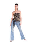 Corset and Blue Jeans. Mid adult woman in a black and gold corset and blue jeans Royalty Free Stock Image