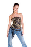 Corset and Blue Jeans. Stylish fashion model in a black and gold corset and blue jeans Stock Image