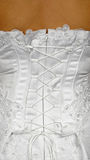 Corset of white wedding dress - rear view Royalty Free Stock Photography