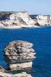 Corsica, Bonifacio, Strait of Bonifacio, beach, Mediterranean Sea, limestone, cliff, rocks, Bouches de Bonifacio. Corsica, 05/09/2017: a man climbed on the Stock Images