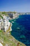 Corsica Coastline. Bonifacio clifftop coastline with rocks and distant town Royalty Free Stock Images