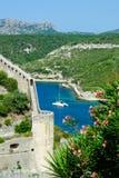 Corsica Coastline. Coastline of town of Bonifacio, island of Corsica, southern France with mountain backdrop Royalty Free Stock Image