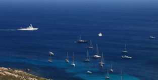 Corsica coastline. With sailing ships and boats Royalty Free Stock Photo