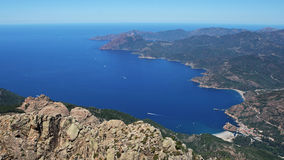 Corsica coastline. Aerial view of Porto and its beach and coasline from 1284 meter high mountain Capu d'Ortu in attractive Calanche area on Corsica island Stock Photography