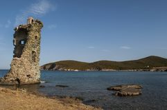 Corsica, Corse, Cap Corse, Upper Corse, France, Europe, island. Corsica, 28/08/2017: the Tower of Santa Maria Chjapella 1549, a ruined Genoese tower at Plage de Royalty Free Stock Photo