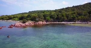 Corsica island people swimming. In summer blue water stock footage