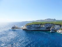 Corsica landscape coastline sea cliffs. At seaside with bright blue sky Royalty Free Stock Image