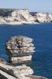 Corsica, Bonifacio, Strait of Bonifacio, beach, Mediterranean Sea, limestone, cliff, rocks, Bouches de Bonifacio. Corsica, 05/09/2017: a man climbed on the Stock Photos