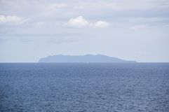 Capraia, Corsica, Corse, Cap Corse, sea, Upper Corse, France, Europe, island, summer,. Corsica, 03/09/2017: the profile of Capraia, the little volcanic island in Royalty Free Stock Images