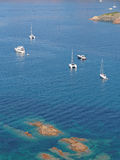Corsica in summer, coast south of Girolata. Sailboats and yachts on the pristine water of Corsica south west coast Stock Image