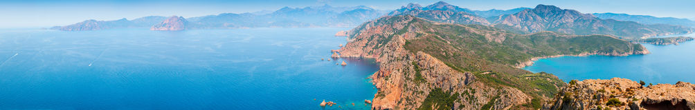 Corsica. Super wide panoramic coastal landscape. South Corsica. Super wide panoramic coastal landscape. Capo Rosso, Piana region, Corse-du-Sud Royalty Free Stock Photos