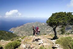 Corsica trekking. A men with backpack walking coastal path Royalty Free Stock Photo