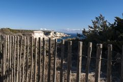 Corsica, Bonifacio, lighthouse, Strait of Bonifacio, beach, Mediterranean Sea, limestone, cliff, rocks, Bouches de Bonifacio. Corsica, 05/09/2017: a wooden fence Stock Images