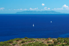 Corsican cape and  Elba island Royalty Free Stock Images