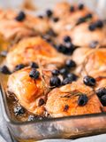 Corsican chicken thighs with rosemary and black olives Royalty Free Stock Photos