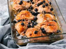 Corsican chicken thighs with rosemary and black olives Stock Photography