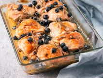 Corsican chicken thighs with rosemary and black olives Stock Images