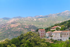 Corsican landscape, old houses and mountain Stock Images