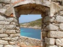 Corsican rectangular stone window. Overlooking the mediterranean sea Stock Images