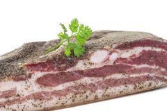 Corsican traditional delicatess smoked piece of pork or boar belly on a white background Stock Photography