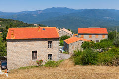 Corsican village, living houses with red tile roofs Royalty Free Stock Photo