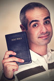 Corss Processed Christian. This is a cross processed image of a senior Christian holding his Holy Bible royalty free stock images