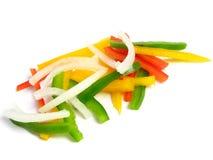 Cortado três pimentas e cebolas da cor Imagem de Stock