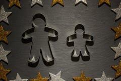 Cortador da cookie para o homem e a criança de pão-de-espécie Fotografia de Stock