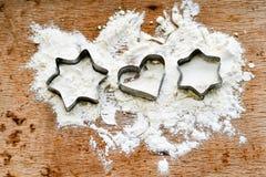 Cortador de las galletas de la estrella de la Navidad foto de archivo