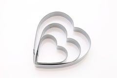 Cortador en forma de corazón de la galleta Fotos de archivo