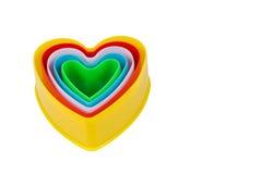 Cortador en forma de corazón de la galleta aislado en blanco Fotografía de archivo
