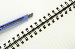 Cortador no caderno Foto de Stock
