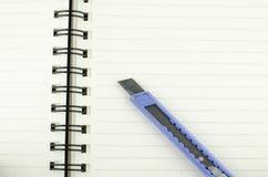 Cortador no caderno Fotos de Stock