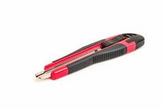Cortador rojo y negro del cuchillo Fotos de archivo