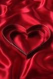 Cortadores en forma de corazón de la galleta Foto de archivo