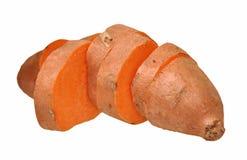 Cortando batatas doces Fotos de Stock Royalty Free