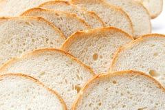 Cortando o pão branco imagens de stock royalty free