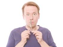 Cortando seu cabelo nasal Fotografia de Stock Royalty Free