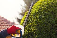Cortando uma conversão com o ajustador de conversão bonde Fotos de Stock Royalty Free