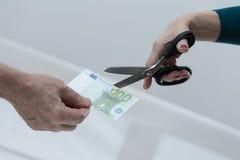 Cortar el billete de banco Fotografía de archivo libre de regalías