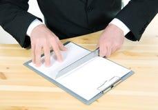 Cortar el contrato Fotografía de archivo libre de regalías