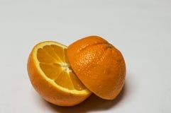 Corte da laranja em uma metade isolado no fundo branco fotografia de stock