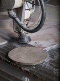 Corte de la presión de agua a través del acero inoxidable Fotografía de archivo