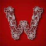 Corte de papel, letra branca W Fundo vermelho Ornamento floral, estilo tradicional do balinese Fotografia de Stock