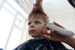 Corte de pelo del niño Fotografía de archivo