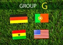 Corte do papel das bandeiras para o campeonato 2014 do futebol, grupo G Imagem de Stock Royalty Free