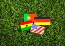 Corte do papel das bandeiras para o campeonato 2014 do futebol, grupo G Fotos de Stock
