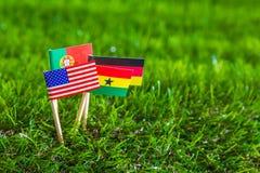 Corte do papel das bandeiras para o campeonato 2014 do futebol, grupo G Fotos de Stock Royalty Free